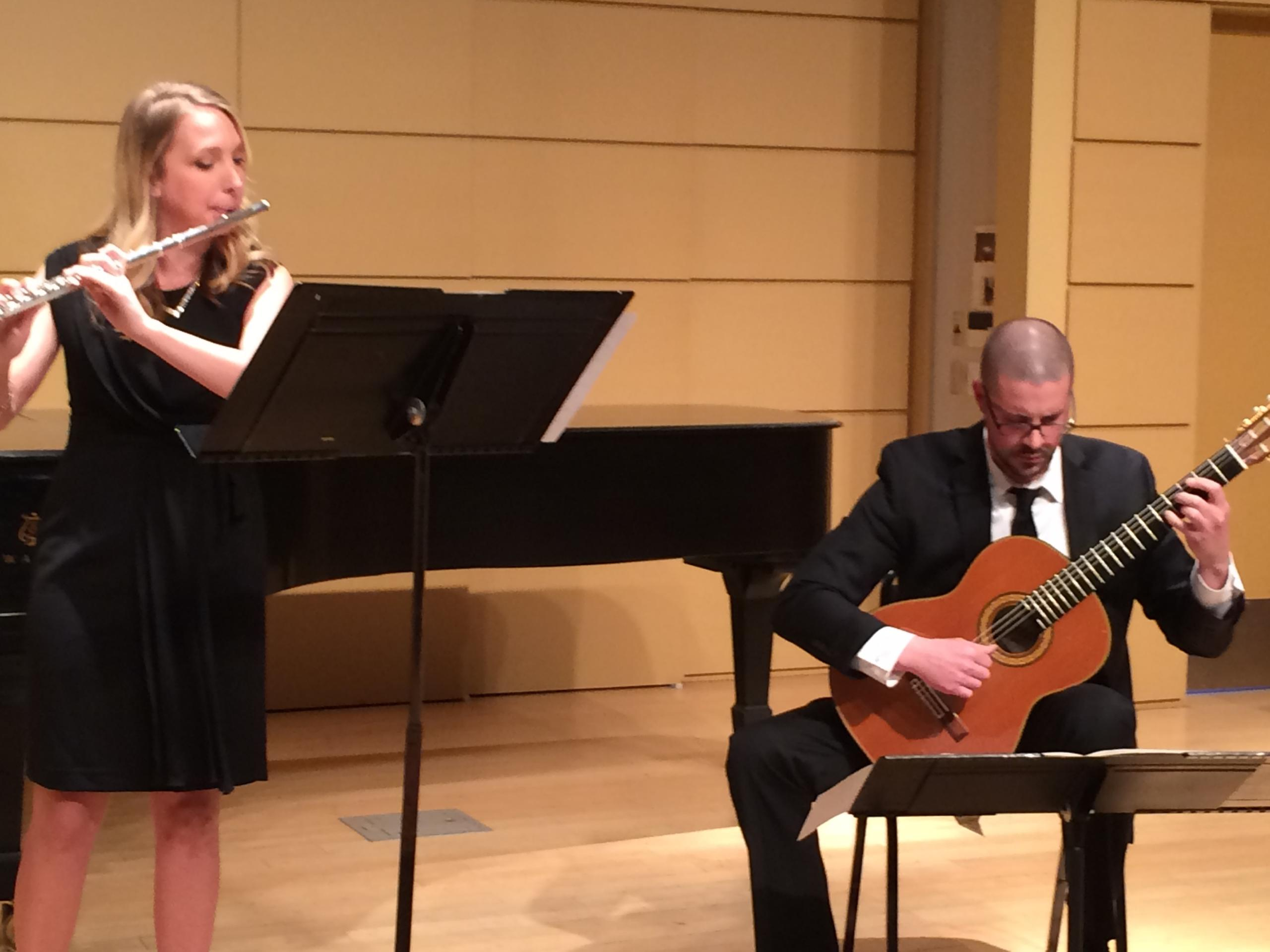 Nate performing a classical guitar and flute duo with friend Cheri France