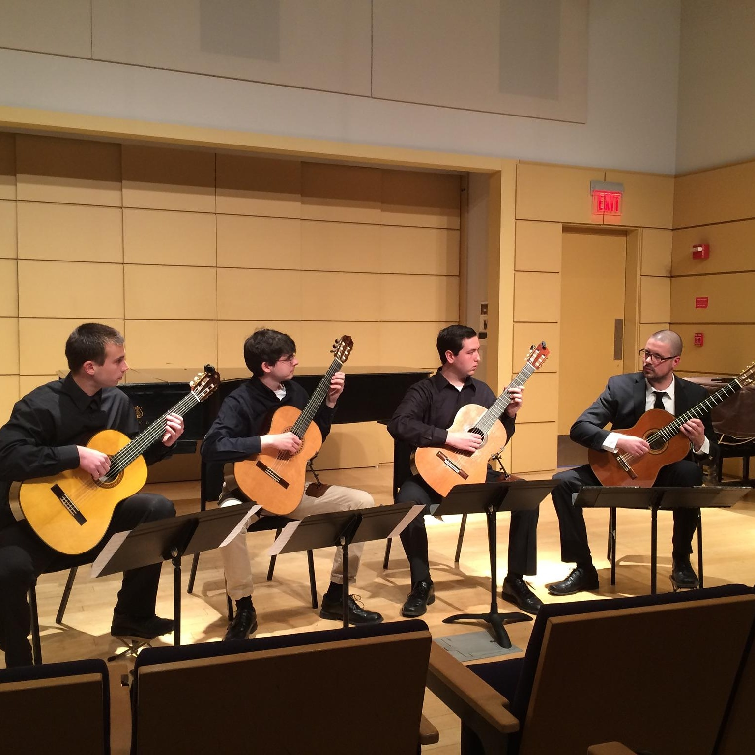 Nate Richards leading the WCU Classical Guitar Ensemble at a performance at West Chester University